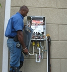 Mr. Go Gas installs a tank-less propane water heater for a client